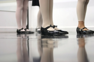 Photo of girls' feet in a tap dance class