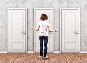 Photo of a young woman in front of three doors