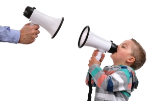 Father and son shouting at each other through megaphone