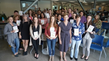Karen after her talk at Druva, surrounded by employees holding copies of her book